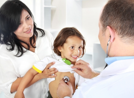 Portrait of a doctor examining heartbeat of the kid with stethoscope Stock Photo - 15047139