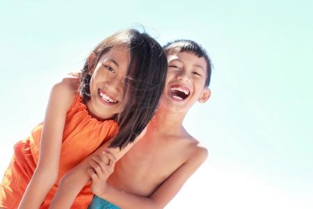 happy kids laughing having fun in the beach Stock Photo - 15114022