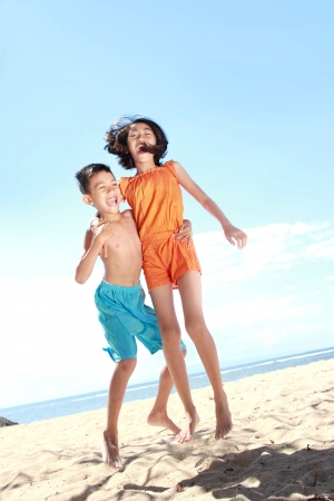 happy smiling asian kids having fun in beautiful sunny day photo