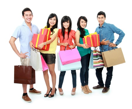 asian girl shopping: Group portrait of people shopping together isolated on white background Stock Photo