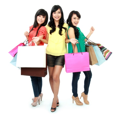 lifestyle shopping: woman shopping with friends together isolated on white background