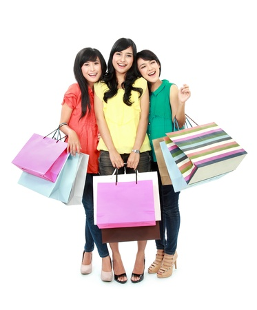 friends shopping: woman shopping with friends together isolated on white background