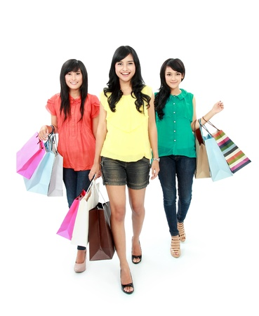 asian shopper: woman shopping with friends together isolated on white background