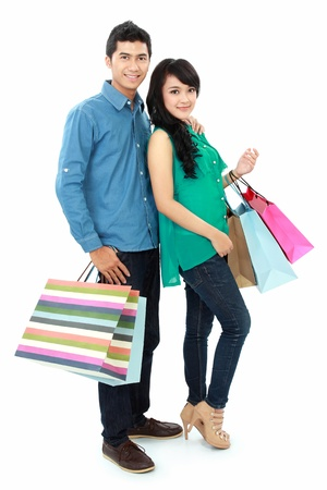 chicas comprando: feliz mujer asi�tica joven y el hombre de compras Foto de archivo