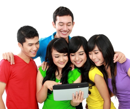 Group of Teenager Friends, one of them hold tablet pc photo