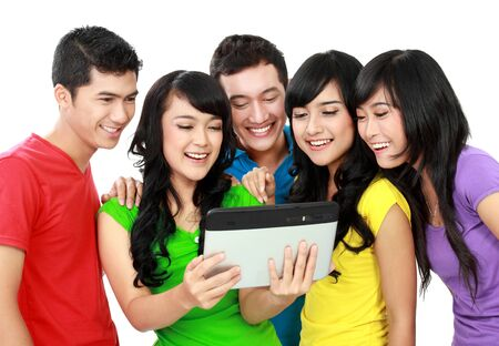 Group of Teenager Friends, one of them hold tab photo