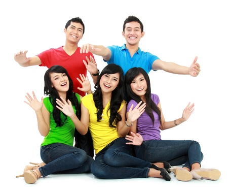 asian success: Group of Teenager Friends with colorful shirt sitting together with arm raised isolated on white background Stock Photo