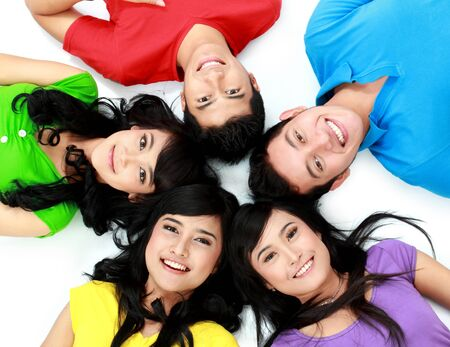 happy group of friends smiling with their heads together on the floor Stock Photo - 16035466