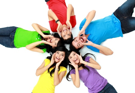 man shouting: happy group of friends screaming with their heads together on the floor Stock Photo