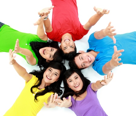 happy group of friends smiling with their heads together on the floor Stock Photo - 16035532
