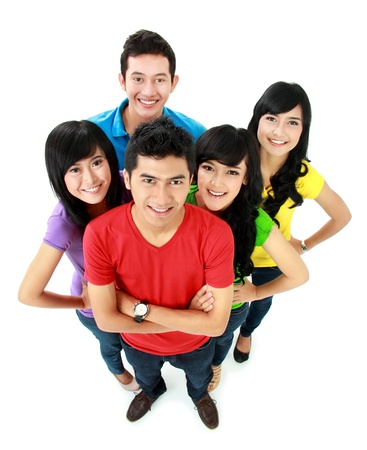 Group of casual young people looking up to camera photo
