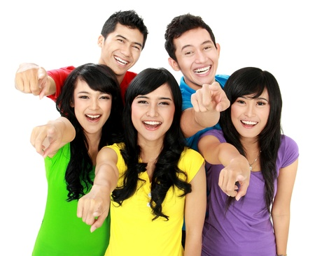 man pointing up: Happy joyful group of friends cheering pointing at camera Stock Photo