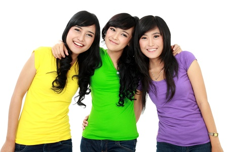 three of girl teenager smiling isolated over white background photo