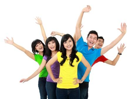 jugendliche gruppe: Gl�ckliche junge asiatische Gruppe von Jugendlichen, die Spa� �ber wei�em Hintergrund Lizenzfreie Bilder