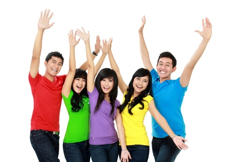 staying: Group of happy teenagers staying together and raise their hands