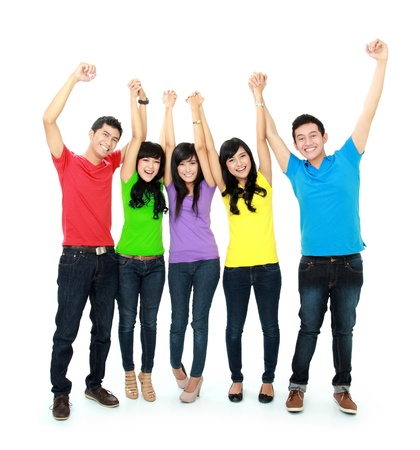 happy young asian people with arm raised photo