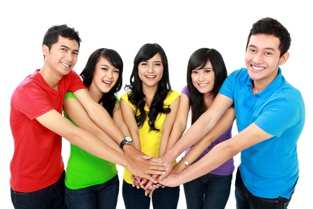 team of friends showing unity with their hands together photo