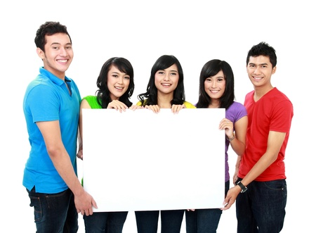 asian group: group of teenagers hold a white banner