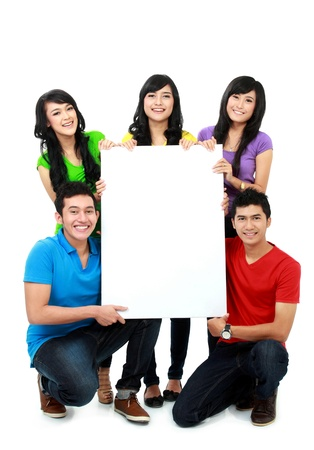 happy asian group of young people hold blank poster photo