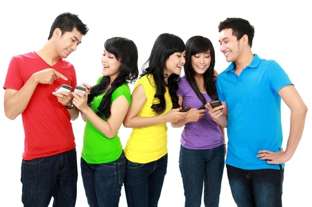 handphone: Group of Teenage Friends hold their handphone Stock Photo