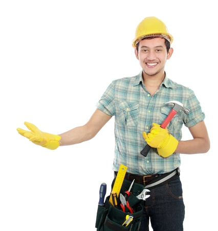 portrait of an happy worker presenting something on white background photo