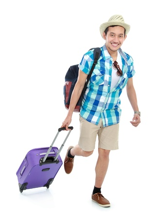 running pants: portrait of a tourist walking with suitcase isolated on white background Stock Photo