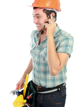 Portrait of an happy construction worker using mobile phone photo