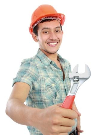 white color worker: Portrait of an happy worker using wrench isolated against white background