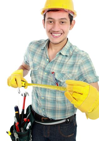 white collars: Portrait of an smiling happy worker using measuring tool