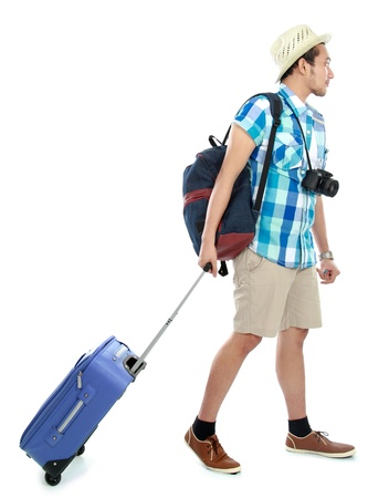 suit case: Attractive Asian tourist man with suit case walking Stock Photo