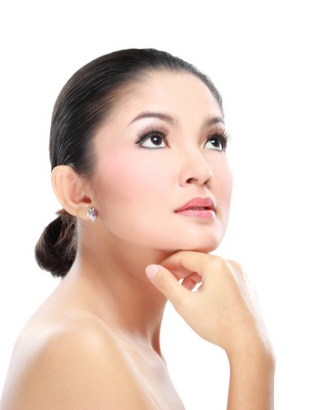 Beautiful asian woman face with smile for skincare, cosmetic, beauty hygiene, makeup, moisturize Imagens