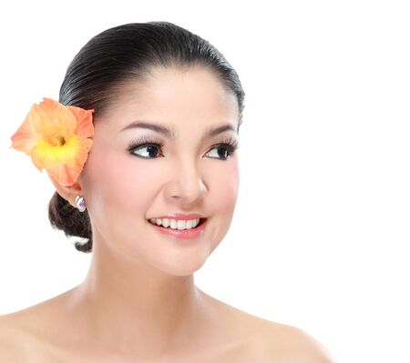 woman face close up: Young beautiful woman smiling with flower isolated on white background Stock Photo