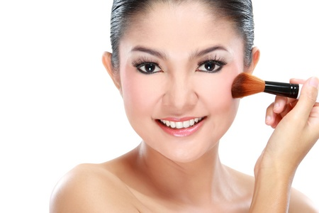 portrait of young beautiful woman with brush for make-up