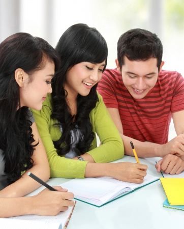 Group of students studying together in a classroom Stock Photo - 16165527