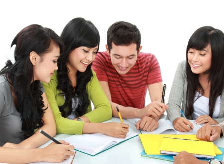 Group of students studying together in a classroom photo