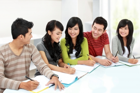 discuss: portrait of happy group of student studying together