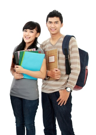 student: potrait of boy and girl students holding notebooks and smiling