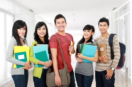 student: potrait of students holding notebooks at school university Stock Photo