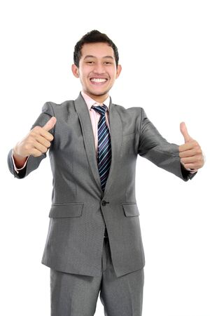 Happy business man showing thumbs up with both hands photo