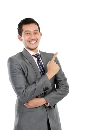 potrait of Happy business man in suit pointing up photo