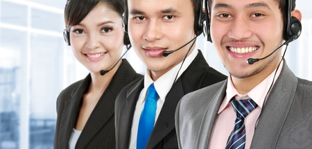 up service: worker call center smiling with colleague in background