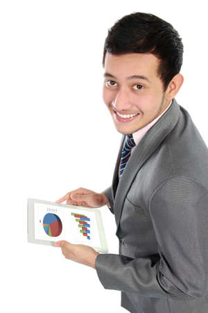 happy businessman using his digital tablet photo