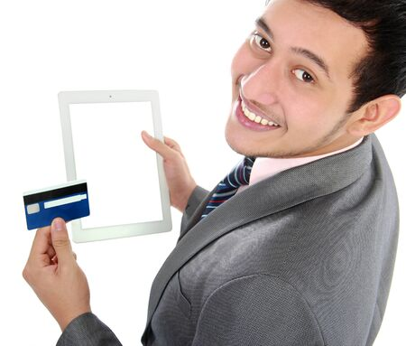 potrait of young business man shop online using tablet and credit card photo