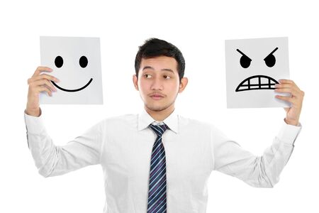 angry boss: Young business man hold the sign of expression