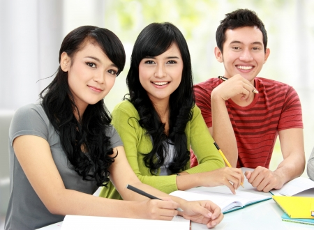 Group of students studying together and looking at camera Stock Photo - 16165584
