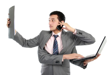 multi tasking: portrait of busy business man do more than one job Stock Photo
