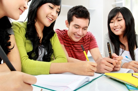 Group of students studying together at home Stock Photo - 16244962