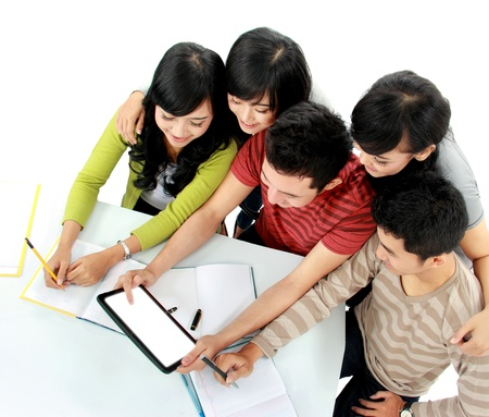 Group of students looking at tablet pc together seen from above photo