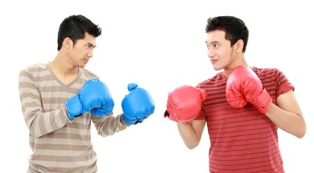 two young man using boxing glove ready to fight