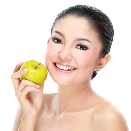 Picture of lovely woman with apple isolated on white background photo